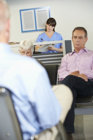 Patients In Doctors Waiting Room photo