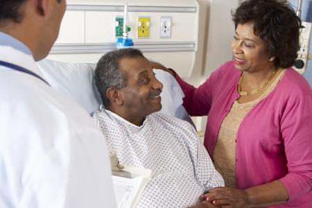 Doctor Talking To Senior Couple On Ward photo