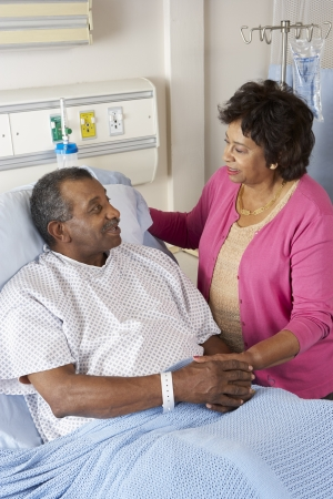 Senior Wife Visiting Husband On Ward photo