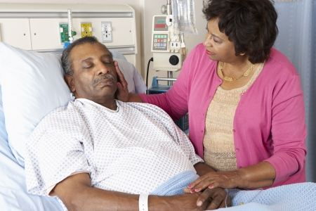 hospital gown: Senior Wife Visiting Husband On Ward