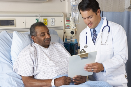 patient on bed: Doctor Explaining Consent Form To Senior Patient