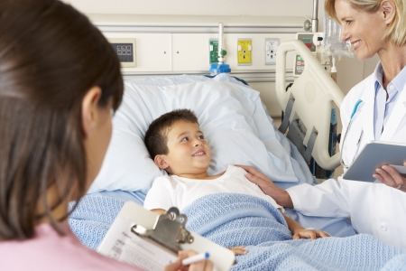 hospital notes: Doctor Using Digital Notepad Whilst Visiting Child Patient