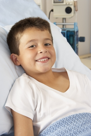 recovery bed: Boy Relaxing In Hospital Bed