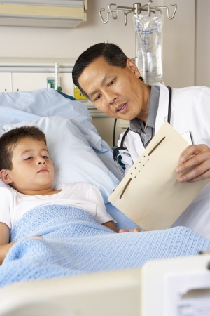 asian hospital: Doctor Visiting Child Patient On Ward