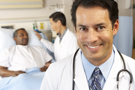 happy patient: Portrait Of Doctor With Patient In Background Stock Photo