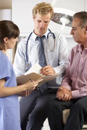 examined: Male Patient Being Examined By Doctor And Intern