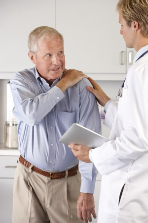 senior pain: Doctor Examining Patient With Shoulder Pain