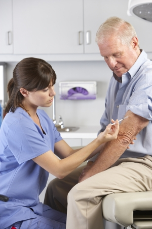 Doctor Giving Male Patient Injection photo