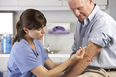 nurse injection: Doctor Giving Male Patient Injection