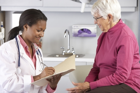 doctor examining woman: Doctor Examining Senior Female Patient