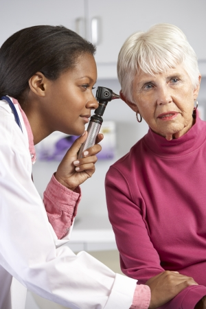 human ear: Doctor Examining Senior Female Patients Ears