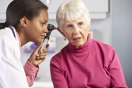 md: Doctor Examining Senior Female Patients Ears
