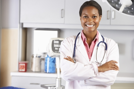 surgery doctor: Portrait Of Female Doctor In Doctors Office Stock Photo