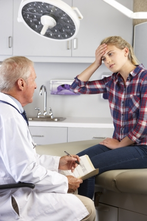 male headache: Teenage Girl Visits Doctors Office With Headaches