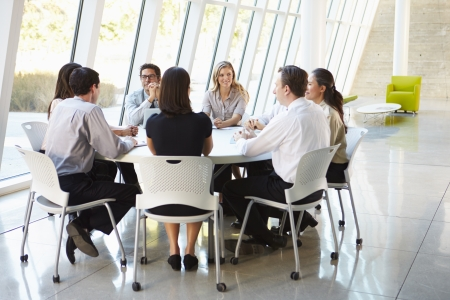 african american woman business: Business People Having Board Meeting In Modern Office