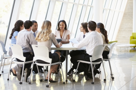 medium group of people: Business People Having Board Meeting In Modern Office