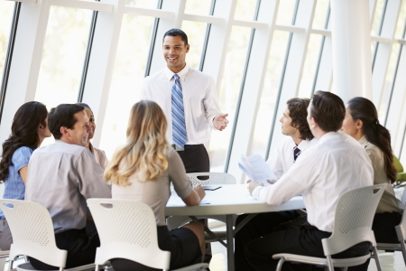Business People Having Board Meeting In Modern Office photo