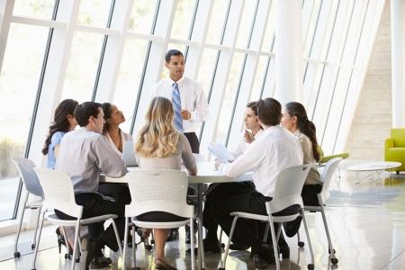 medium group: Business People Having Board Meeting In Modern Office