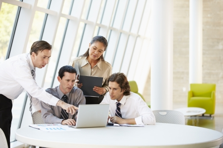Businesspeople Having Meeting Around Table In Modern Office Stock Photo - 18735595