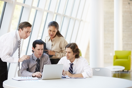 Businesspeople Having Meeting Around Table In Modern Office Stock Photo - 18735556