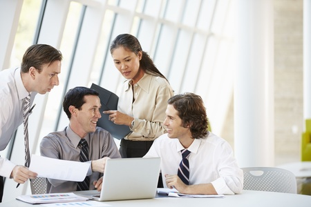 Businesspeople Having Meeting Around Table In Modern Office Stock Photo - 18736813