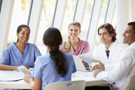 Medical Team Meeting Around Table In Modern Hospital Stock Photo - 18735637