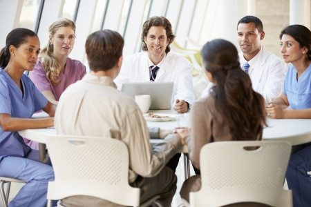 modern doctor: Medical Team Discussing Treatment Options With Patients