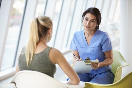 modern hospital: Nurse Meeting With Teenage Girl In Modern Hospital