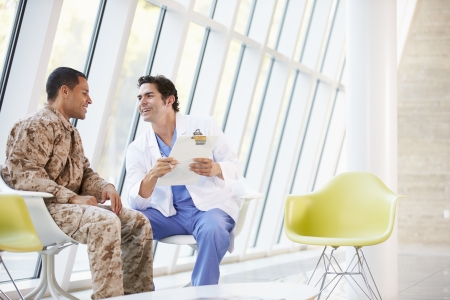 counselling: Doctor Counselling Soldier Suffering From Stress