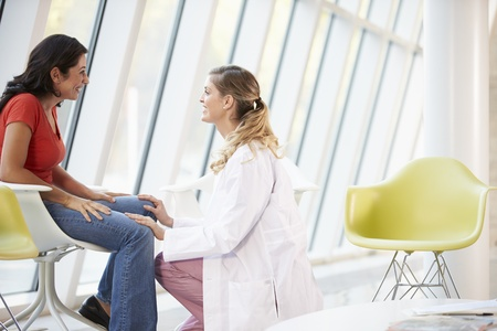 counsellor: Female Doctor Offering Counselling To Depressed Woman Stock Photo
