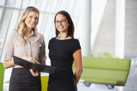Businesswomen Having Informal Meeting In Modern Office Stock Photo - 18736755