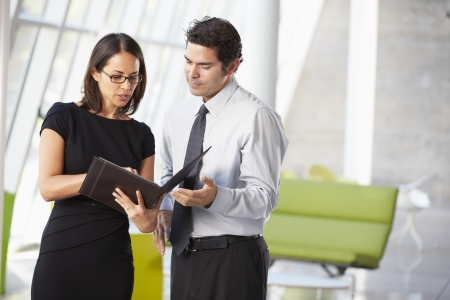 Businessman And Businesswomen Having Meeting In Office Stock Photo - 18726231