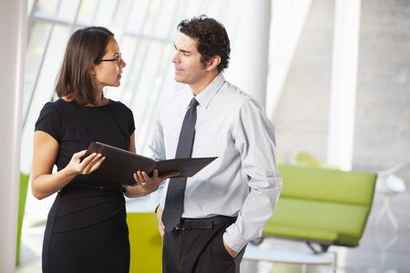 Businessman And Businesswomen Having Meeting In Office Stock Photo - 18736739