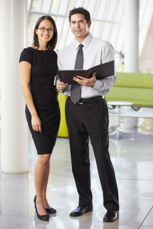 Businessman And Businesswomen Having Meeting In Office Stock Photo - 18736051