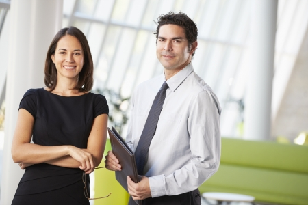 modern office space: Businessman And Businesswomen Having Meeting In Office