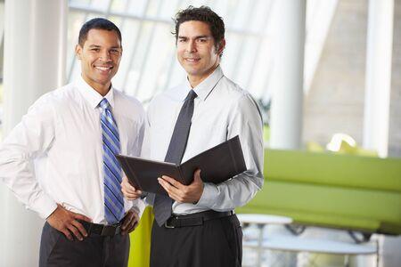 Businessmen Having Informal Meeting In Modern Office Stock Photo - 18726327