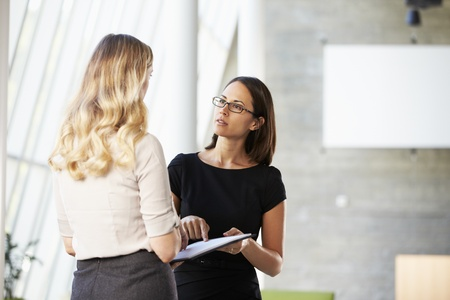 Two Businesswomen Having Informal Meeting In Modern Office Stock Photo - 18735555