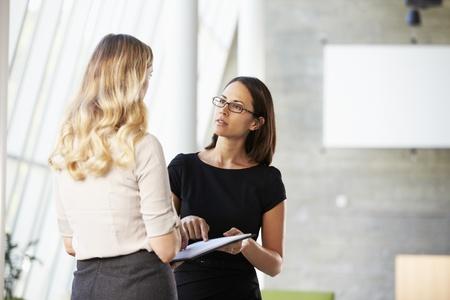Two Businesswomen Having Informal Meeting In Modern Office Stock Photo - 18735555