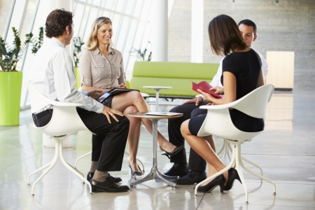 Four Businesspeople Having Meeting In Modern Office Stock Photo - 18736542