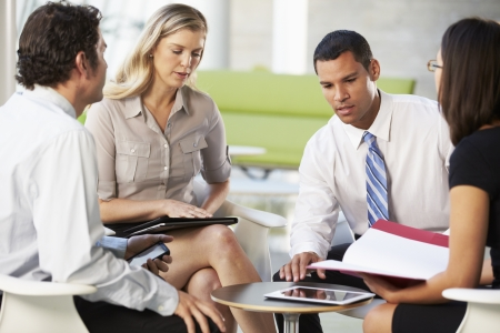 Four Businesspeople Having Meeting In Modern Office Stock Photo - 18736536