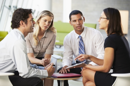 Businesspeople With Digital Tablet Having Meeting In Office Stock Photo - 18736484
