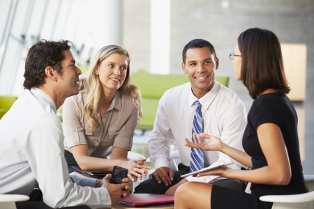 black lady talking: Businesspeople With Digital Tablet Having Meeting In Office