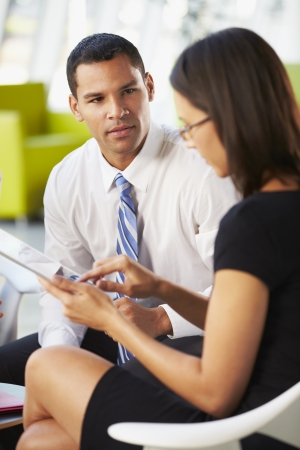 Businesspeople With Digital Tablet Having Meeting InOffice Stock Photo - 18736596