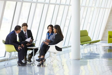people in office: Businesspeople Having Meeting In Modern Office Stock Photo