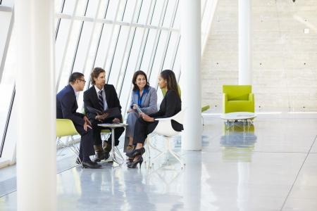meeting: Businesspeople Having Meeting In Modern Office Stock Photo