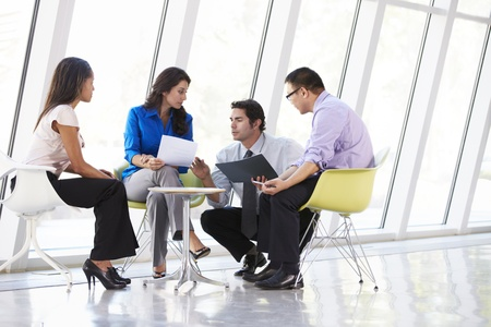asian business team: Businesspeople Having Meeting In Modern Office Stock Photo