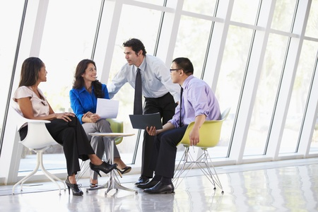 Businesspeople Having Meeting In Modern Office Stock Photo - 18736764