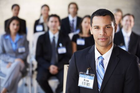 african american woman business: Businessman Delivering Presentation At Conference Stock Photo