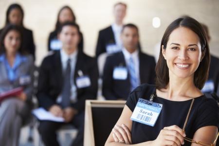 public speaker: Businesswoman Delivering Presentation At Conference
