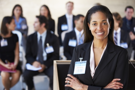 african american male: Businesswoman Delivering Presentation At Conference